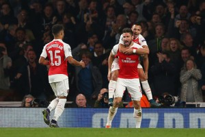 Olivier Giroud and his teammates celebrate his goal for Arsenal in 2-0 win over Bayern Munich.