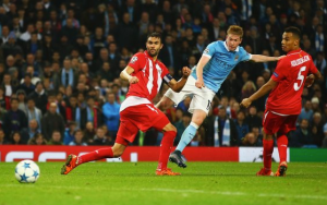 Kevin De Bruyne struck an injury-time winner as Manchester City came from behind to claim a dramatic 2-1 win over Sevilla in the Champions League.